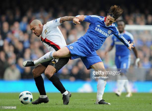 Nigel De Jong of Manchester City and Fernando Torres of Chelsea battle for the ball during the Barclays Premier League match between Chelsea and...
