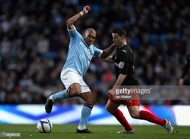 Nigel De Jong of Manchester City and Ian Harte of Reading battle for the ball during the FA Cup sponsored by EOn Sixth Round match between Manchester...