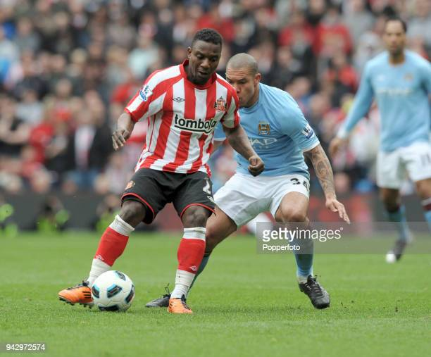 Nigel De Jong of Manchester City and Stephane Sessegnon of Sunderland in action during the Barclays Premier League match between Manchester City and...