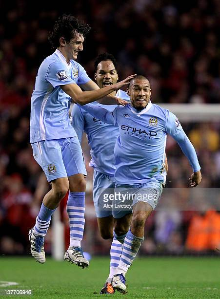 Nigel de Jong of Manchester City celebrates scoring the opening goal with Stefan Savic and Joleon Lescott during the Carling Cup Semi Final Second...