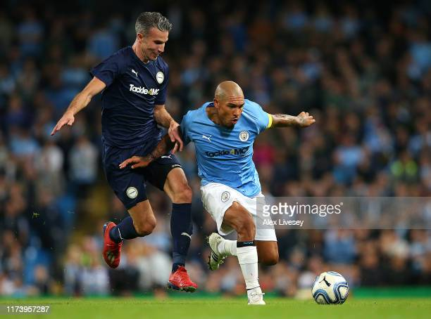 Nigel de Jong of Manchester City legends is tackled by Robin Van Persie of Premier League AllStarts XI during the Vincent Kompany testimonial match...