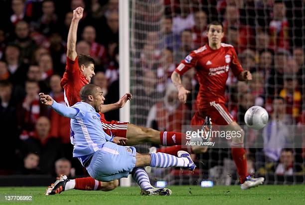 Nigel de Jong of Manchester City scores the opening goal during the Carling Cup Semi Final Second Leg match between Liverpool and Manchester City at...