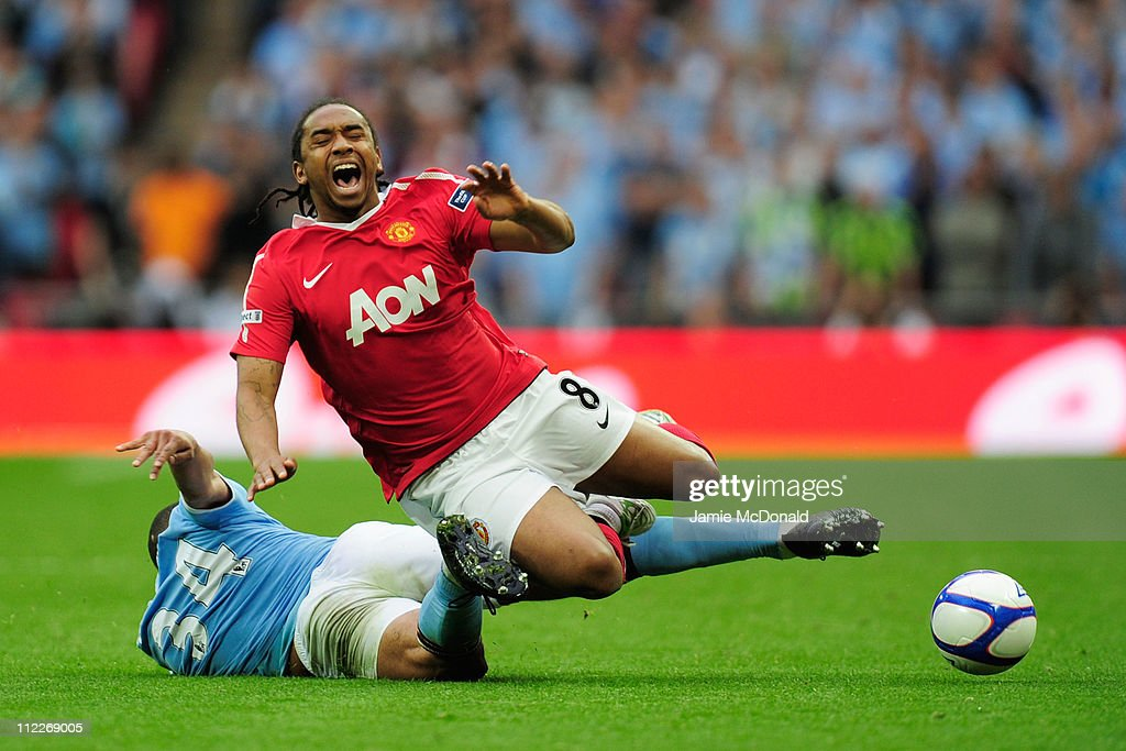 Nigel de Jong of Manchester City tackles Anderson of Manchester United during the FA Cup sponsored by E.ON semi final match between Manchester City and Manchester United at Wembley Stadium on April 16, 2011 in London, England.