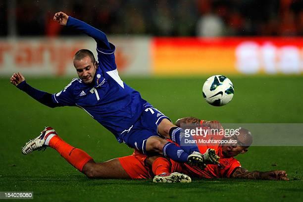 Nigel De Jong of Netherlands tackles Marc Pujol of Andorra during the FIFA 2014 World Cup Qualifier between Netherlands and Andorra on October 12...