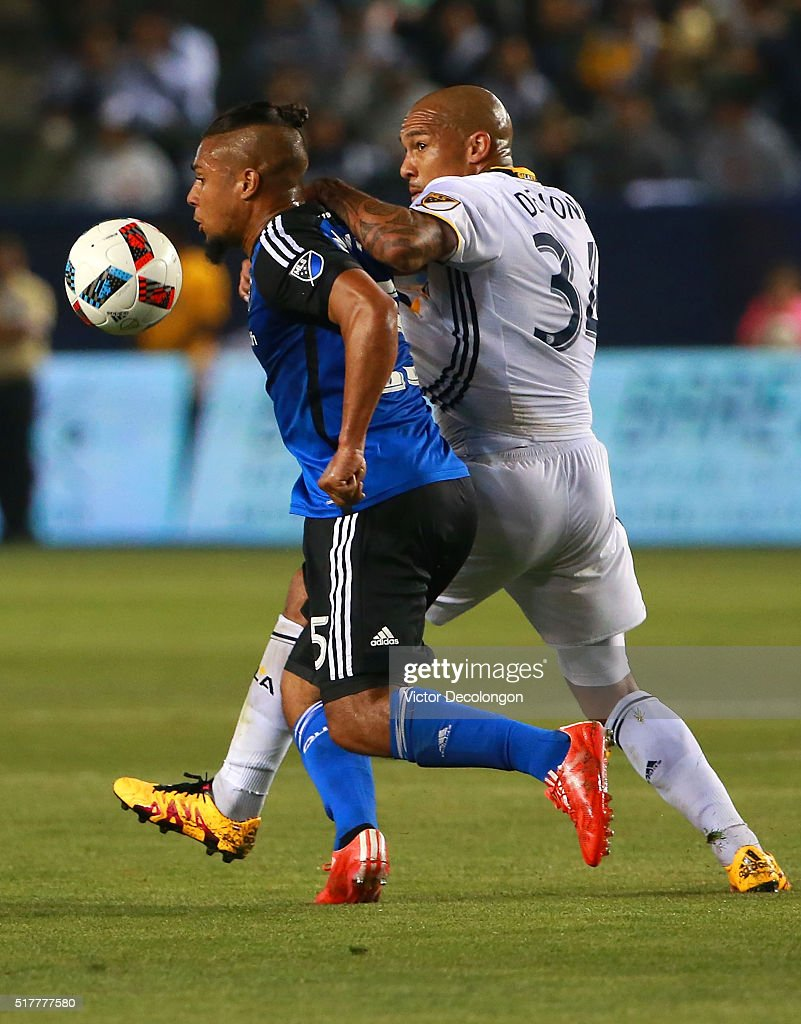 Nigel de Jong #34 of the Los Angeles Galaxy and Quincy Amarikwa #25 of the San Jose Earthquakes vie for the ball during the second half of their MLS match at StubHub Center on March 19, 2016 in Carson, California. The Galaxy defeated the Earthquakes 3-1.