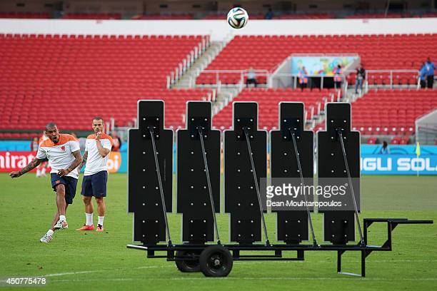 Nigel de Jong takes a free kick during the Netherlands training session at the 2014 FIFA World Cup Brazil held at the Estadio BeiraRio on June 17...