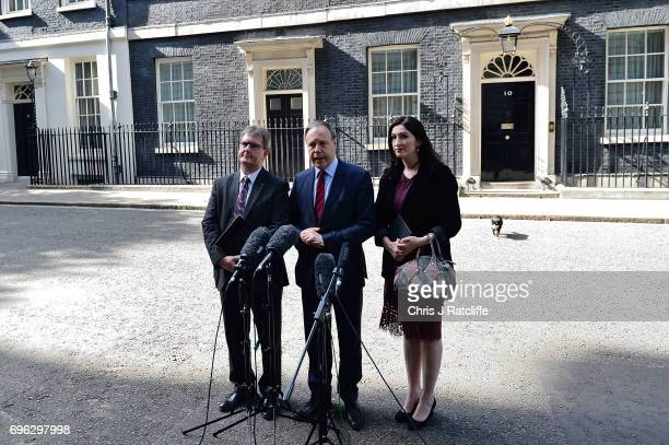 Nigel Dodds deputy leader of the Democratic Unionist Party stands with colleagues as he speaks to the media outside 10 Downing Street on June 15 2017...