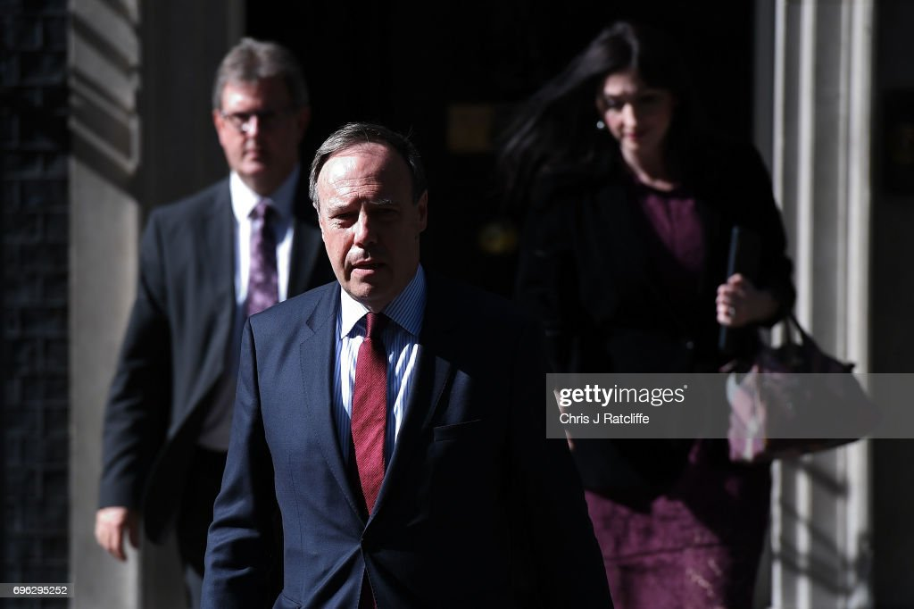 Nigel Dodds, deputy leader of the Democratic Unionist Party (DUP) walks with colleagues as he prepares to speak to the media outside 10 Downing Street on June 15, 2017 in London, England. Prime Minister Theresa May held a series of meetings with the main Northern Ireland political parties today to allay mounting concerns over a government deal with the DUP in the wake of the UK general election.