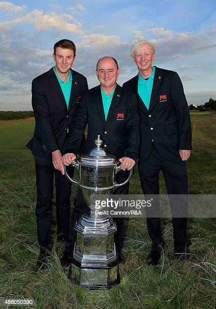 Nigel Edwards the victorious Great Britain and Ireland team captain poses with the English players Ashley Chesters and Jimmy Mullen and the trophy...