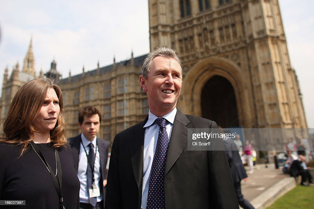 Nigel Evans (C), the Deputy Commons Speaker who was arrested at the weekend over rape and sexual assault allegations, is ushered away by aides after addressing the media in front of the Houses of Parliament on May 7, 2013 in London, England. Mr Evans, the Conservative MP for Ribble Valley in Lancashire, has been questioned about alleged attacks on two men, something which he strenuously denies.