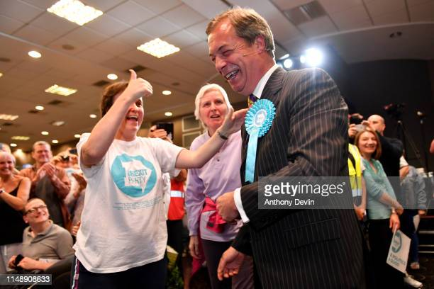 Nigel Farage arrives to speak during a Brexit Party rally at the John Smith's Stadium on May 13 2019 in Huddersfield England Nigel Farage the former...