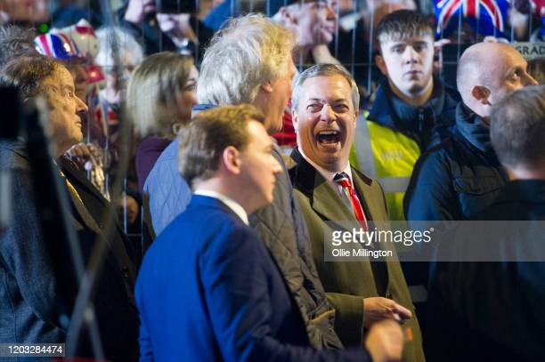 Nigel Farage backstage talking with British Businessman Tim Martin moments before talking to the assembled crowd in Parliament Square at the Leave...