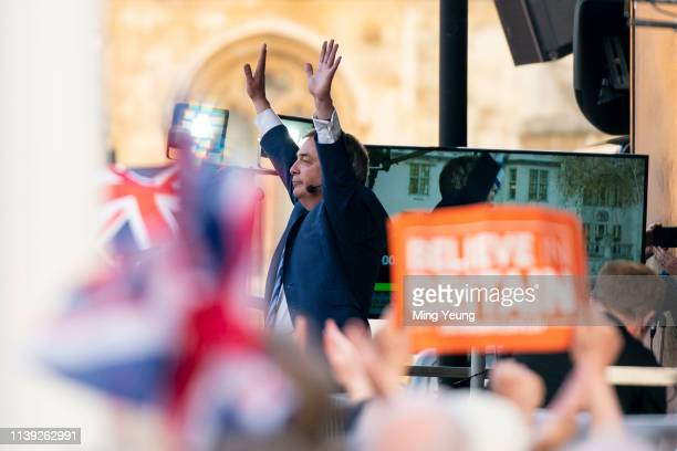 Nigel Farage celebrates on stage during a proBrexit rally at Parliament Square on March 29 2019 in London England Today proBrexit supporters...