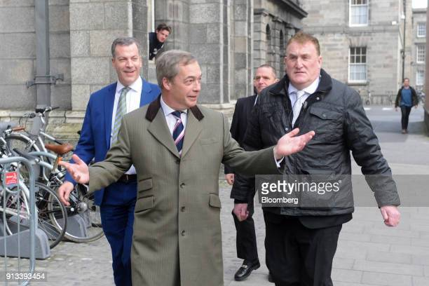 Nigel Farage former leader of the UK Independence Party gestures as he arrives to speak at Trinity College Dublinin Dublin Ireland on Friday Feb 2...