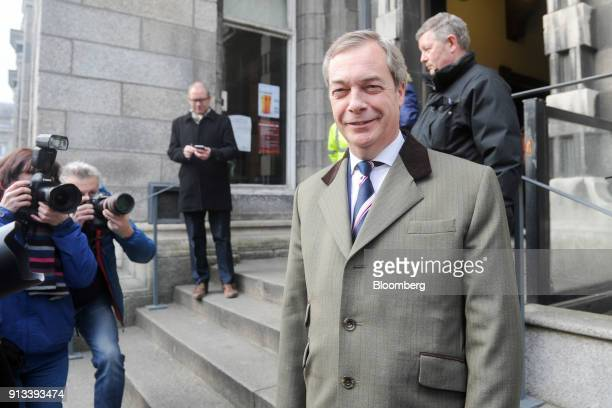 Nigel Farage former leader of the UK Independence Party poses for photographers as he arrives to speak at Trinity College Dublinin Dublin Ireland on...