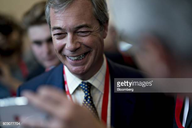 Nigel Farage former leader of the UK Independence Party takes a selfie photograph with an attendee at the Conservative Political Action Conference in...