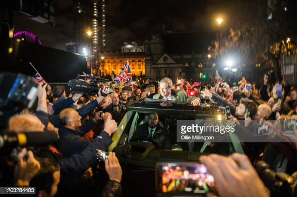 Nigel Farage gestures to fans through his car sunroof as he exits the Leave Means Leave Brexit Celebration on January 31, 2020 in London, United...