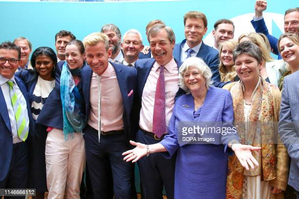 Nigel Farage leader of the Brexit Party along with the newly elected Brexit Party Members of the European Parliament are seen during the EU election...
