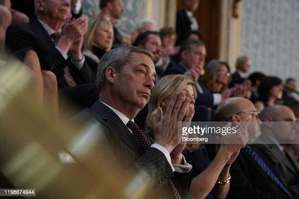 Nigel Farage, leader of the Brexit Party, applauds as U.S. President Donald Trump delivers a State of the Union address to a joint session of...