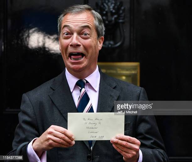 Nigel Farage leader of the Brexit party hands in a petition to 10 Downing Street on June 7 2019 in London England Nigel Farage and Richard Tice of...