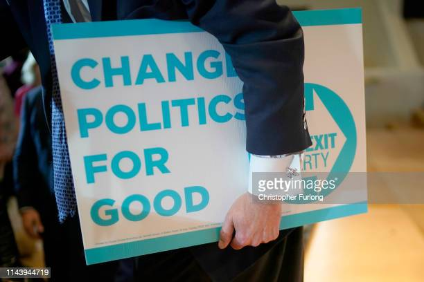 Nigel Farage leader of the Brexit Party holds a Brexit Party placard during the Brexit Party rally at the Albert Hall conference centre on April 20...