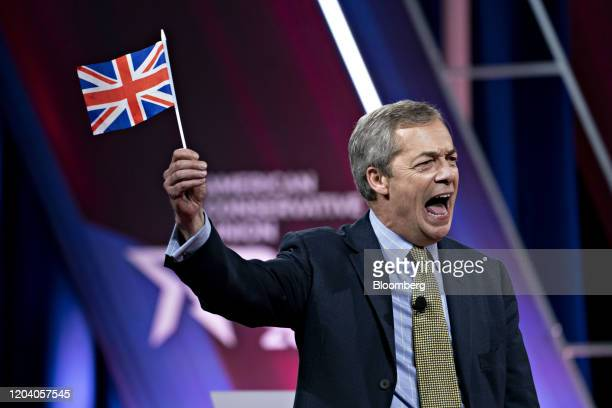 Nigel Farage, leader of the Brexit Party, holds a British Union flag, also known as a Union Jack, while speaking during the Conservative Political...
