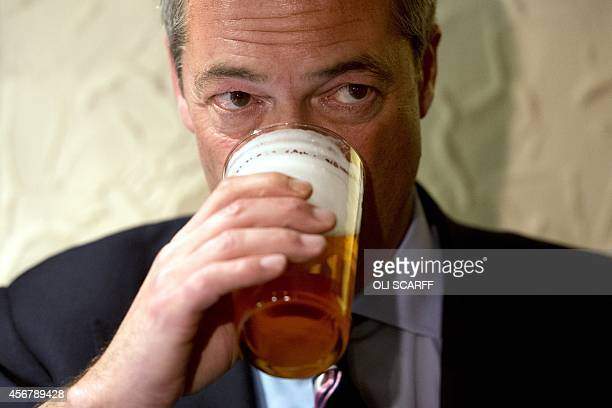 Nigel Farage leader of the UK Independence Party enjoys a pint of beer in The Gardeners Arms pub after unveiling campaign posters ahead of the...