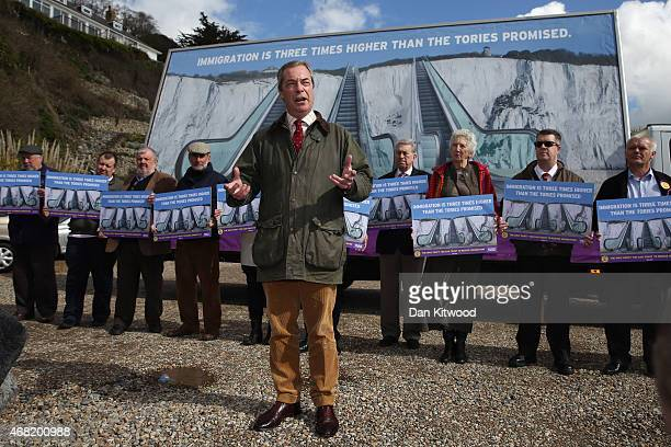 Nigel Farage leader of the UK Independence Party launches their party's new billboard on March 31 2015 in Dover England UKIP unveiled their latest...