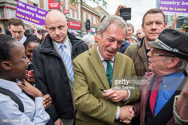 Nigel Farage, leader of the UK Independence Party, meets supporters in Bexleyheath on June 14, 2016 in London, England. Mr Farage is campaigning for...