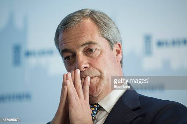 Nigel Farage leader of the UK Independence Party pauses as he listens during the Milken Institute London summit in London UK on Tuesday Oct 28 2014...