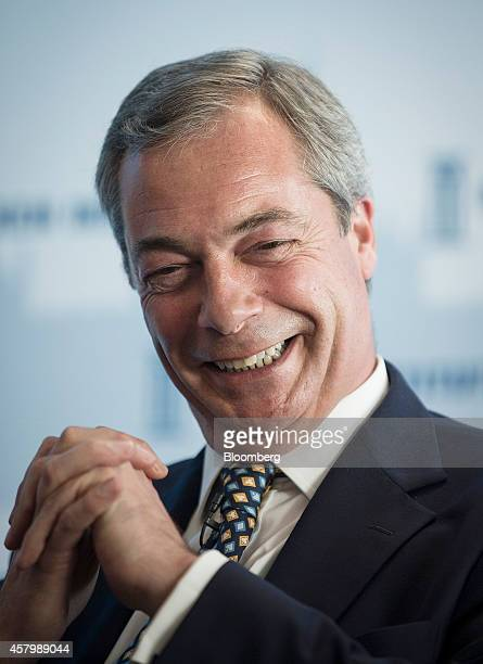 Nigel Farage leader of the UK Independence Party reacts as he listens during the Milken Institute London summit in London UK on Tuesday Oct 28 2014...