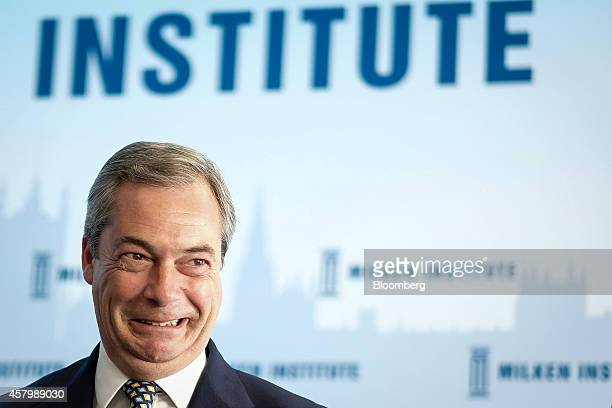 Nigel Farage leader of the UK Independence Party reacts as he speaks during the Milken Institute London summit in London UK on Tuesday Oct 28 2014...