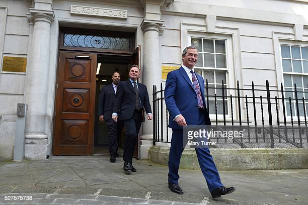 Nigel Farage, leader of the United Kingdom Independence Party, exits Europe House, followed by London mayoral candidate Peter Whittle and David...
