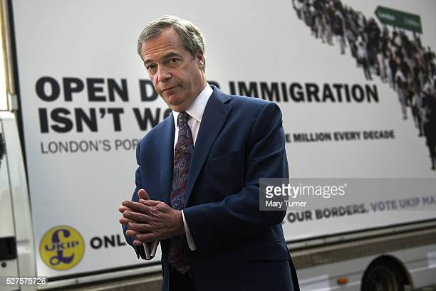 Nigel Farage leader of the United Kingdom Independence Party is pictured in front of the party's final election poster of the London Mayoral election...