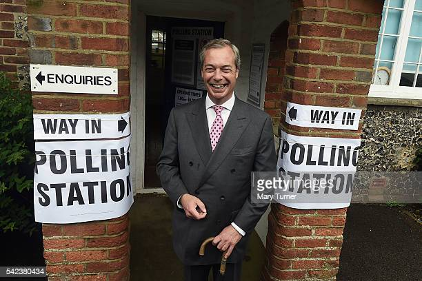 Nigel Farage leader of UKIP and Vote Leave campaigner poses for photographs ahead of registering his vote in the UK's EU referendum at his local...