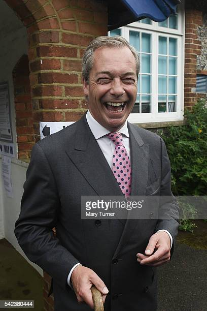 Nigel Farage leader of UKIP and Vote Leave campaigner shares a joke with the media after registering his vote in the UK's EU referendum at his local...