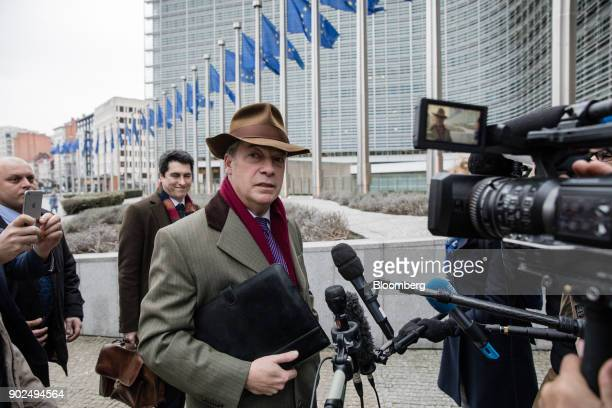 Nigel Farage member of European Parliament and former leader of the UK Independence Party speaks to journalists as he arrives for a meeting with EU...