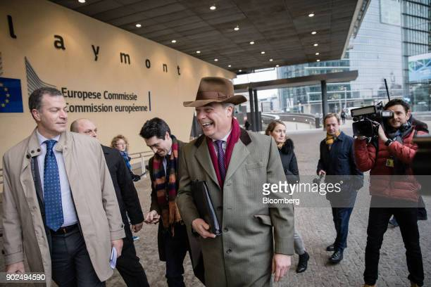 Nigel Farage member of European Parliament and former leader of the UK Independence Party center reacts as he arrives for a meeting with EU Chief...