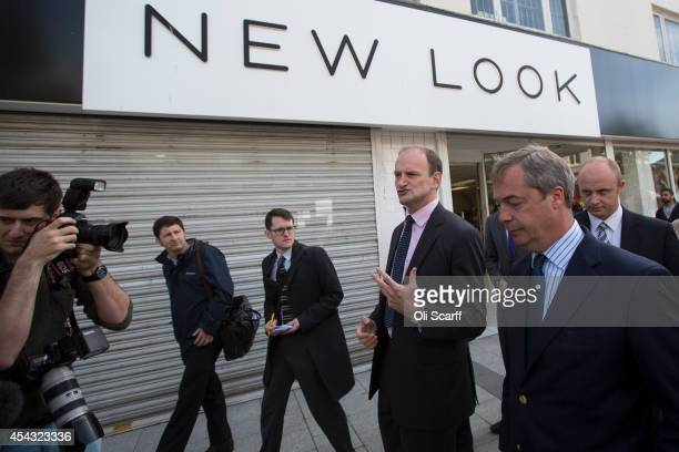 Nigel Farage the Leader of the UK Independence Party and Douglas Carswell MP walk through ClactononSea the day after Mr Carswell announced he is...