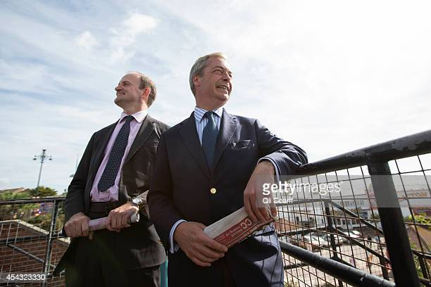 Nigel Farage the Leader of the UK Independence Party and Douglas Carswell admire the seafront at ClactononSea the day after Mr Carswell announced he...
