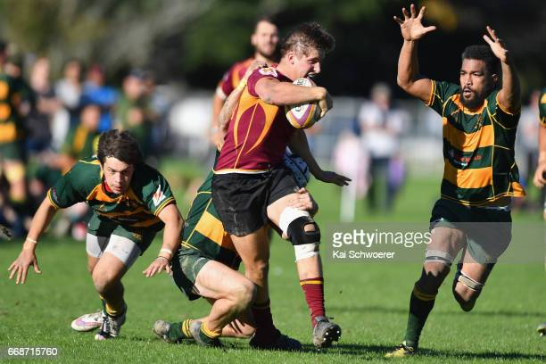 Nigel Gibb of University is tackled during the Hawkins Premier Cup match between Canterbury University and Belfast RFC at Ilam Fields on April 15...