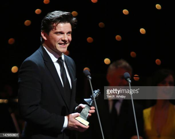 Nigel Harman accepts the award for Best Performance in a Supporting Role in a Musical for Shrek The Musical at the 2012 Olivier Awards at The Royal...