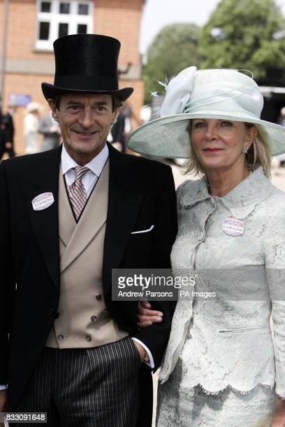 Nigel Havers and his Fianc Georgiana Bronfman pose for photographers as they arrive at the Ascot Racecourse Berkshire for the first day of Royal Ascot