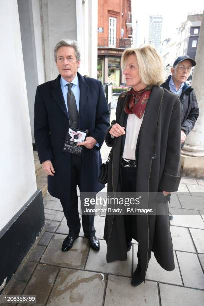 Nigel Havers and his wife Georgiana Bronfman arrive for the memorial service for photographer Terry O'Neill at The Grosvenor Chapel in London's...