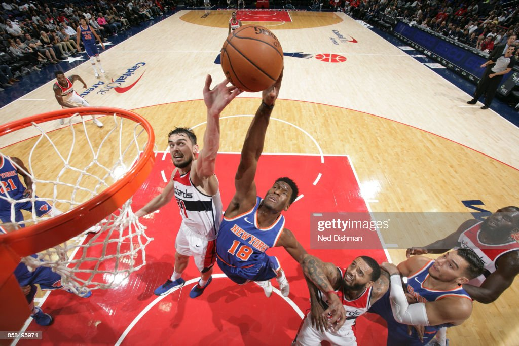 Nigel Hayes #18 of the New York Knicks shoots the ball against Tomas Satoransky #31 of the Washington Wizards during the preseason game on October 6, 2017 at Capital One Arena in Washington, DC.
