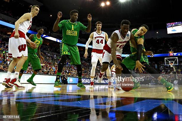 Nigel Hayes of the Wisconsin Badgers and Dillon Brooks of the Oregon Ducks battle for a loose ball in the first half during the third round of the...