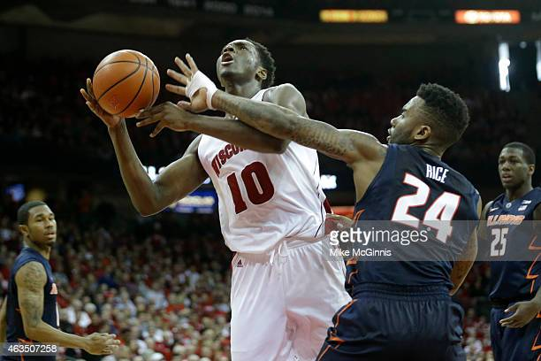 Nigel Hayes of the Wisconsin Badgers draws the foul while driving to the hoop during the second half against the Illinois Fighting Illini at Kohl...