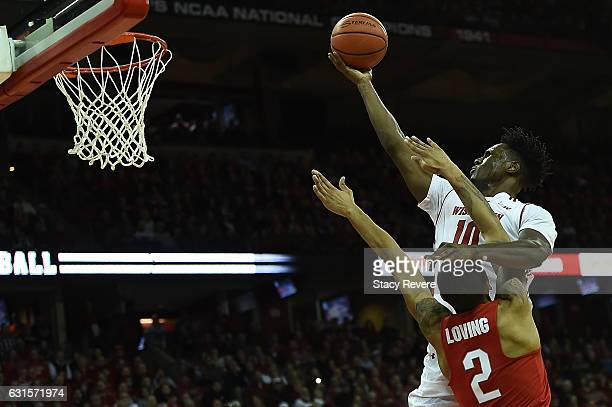 Nigel Hayes of the Wisconsin Badgers drives to the basket against Marc Loving of the Ohio State Buckeyes during the first half of a game at the Kohl...