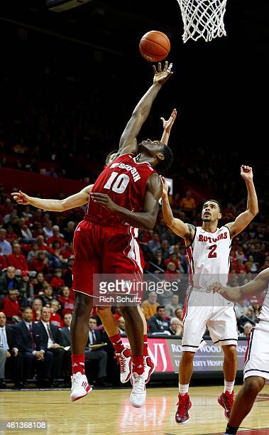 Nigel Hayes of the Wisconsin Badgers grabs a rebound against the Rutgers Scarlet Knights during the first half of a college basketball game at the...