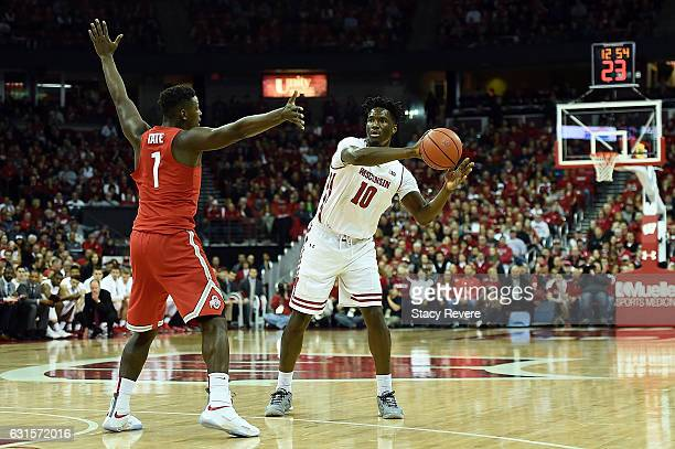 Nigel Hayes of the Wisconsin Badgers is defended by Jae'Sean Tate of the Ohio State Buckeyes during the first half of a game at the Kohl Center on...